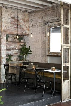 exposed wall and bench with small tables