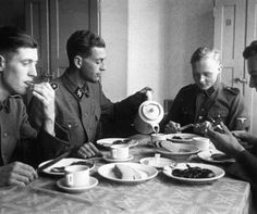 Dutch volunteers of the Westland Waffen SS regiment take their tea in the barracks in Munich, 1940.