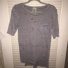 FreePeople: Striped Tee with distress Super fun distressed tee! Longer in the back (about 2 inches) slits on the side so perfect for slightly tucking in to shorts or jeans. Sleeves hit right above the elbow. Small pocket on the right. Worn once, perfect condition! Free People Tops Tees - Short Sleeve