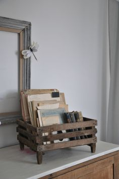 Put legs on a crate or basket to give it importance.   atelier 2013 049