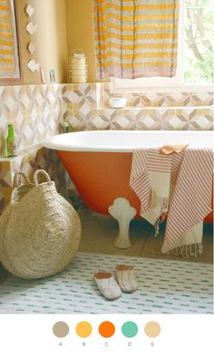 there are sooooooo elements of my dream bathroom here. Clawfoot tub; natural light; mix of yellow, white, & grey; and funky patterns.