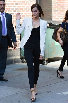 Emma Watson wearing black skinny trousers and a white jacket for a television appearance in New York.