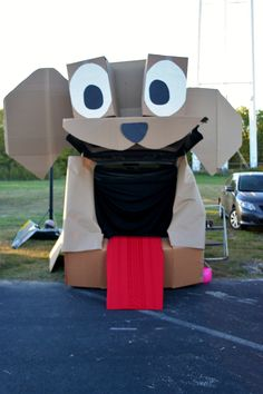 My trunk or treat dog vehicle this year!  Free to make using boxes, paper, an old black sheet and an old red tablecloth!