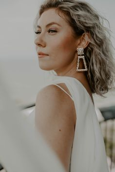 In this photo is a bohemian bride wearing gorgeous vintage earrings. If you're looking for wedding jewelry inspiration, these earrings are absolutely breathtaking. This bride's hair is also worthy of a bohemian bride hairstyle insporation board on any son to be bride's pinterest. She has the perfect, simple look as far as natural wedding make-up goes. Looking for a wedding photographer in the great smokey mountains? Look no further. Emily is an eastern tennessee elopement photographer. Boho Wedding Hair, Elope Wedding, Wedding Jewelry, Wedding Jewellery Inspiration, Smoky Mountain Wedding, Bohemian Bride, Bride Hairstyles, How To Feel Beautiful, Vintage Earrings