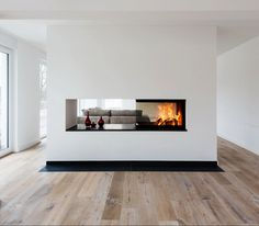 Three-sided viewable fireplace as a room divider between kitchen and living room. 94 The Key Features Of Luxury Living Room Interior You Must Have 9 - homeexalt . Home Fireplace, Modern Fireplace, Living Room With Fireplace, Fireplace Design, Fireplace Kitchen, Fireplaces, Double Sided Fireplace, Living Room Interior, Home And Living