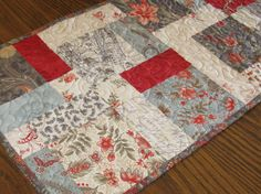 Quilted table runner with classy fabrics from the Moda Etchings collection