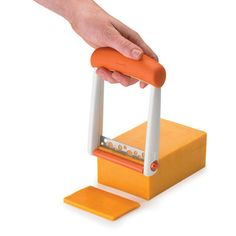 Breeze through food preparation tasks with the beautifully designed Chef'n Slicester Cheese Slicer (Apricot). Great for semi-soft block cheeses, this cheese slicer creates perfect slices for burgers, paninis, sandwiches and more. Handy Gadgets, Home Gadgets, Cooking Gadgets, Gadgets And Gizmos, Cooking Tools, Cooking Box, Fitness Gadgets, Cooking Dishes, Girl Cooking