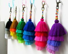 Pom Pom Beaded Keychain Long Tassel Keychain with Pretty Beadwork and Large Wool Pom Pom Wholesale Pom Pom Craft Supplies and Accessories Keychain or Purse Charm / Swag 4cm wool pom pom complete with wood and glass colored beadwork and 3 x 4 silky luxe tassels, comes complete with brass clasp. Total length approx 7 If you prefer specific pom pom and tassel colors then please confirm after checkout otherwise we will select and make random colors. We supply these at wholesale prices plus...