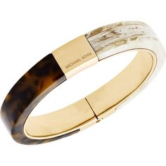 Tort and horn acetates pair beautifully in this glamorous Michael Kors Jewelry hinged bangle bracelet.