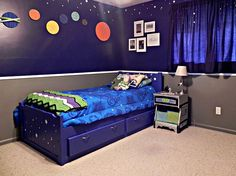 Super Space #Geek Bedroom for @Mad in Crafts' son who loves Star Wars, Doctor Who, and Toy Story. Check out that galactic bed, robot side table, and Buzz Lightyear colored blanket!