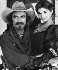 "QUIGLEY DOWN UNDER - American sharpshooter (Tom Selleck) is hired by an Australian rancher (Alan Rickman) to kill aborigines which live on the rancher's property. - Directed by Simon Wincer (""Lonesome Dove"") - Pictured: Tom Selleck & Laura San Giacomo Laura San Giacomo, Tom Selleck, Western Film, Western Movies, Movie Stars, Movie Tv, Tv Westerns, Cowboy Up, Thing 1"