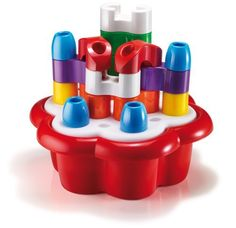 Quercetti Daisy Box Castle (8007905002728) Build tall structures or sort by shape and color Store pegs inside case for take-along fun Ages 12 months and up