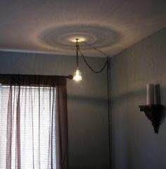 swag lighting ideas   Repurposed Glass Insulator Swag Light.