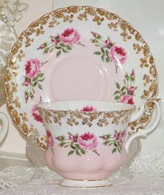 Royal Albert...pink and white teacup and saucer with delicate roses encircling both pieces
