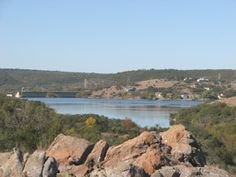 """This picture is of The Lake Buchanan Dam taken from a cliff of rocks at Inks Lake State Park in Texas.  My husband and I """"love"""" to go here and on this day we had taken a wonderful long hike.  It is so peaceful and beautiful. Photo Credit to Rhonda Hall."""