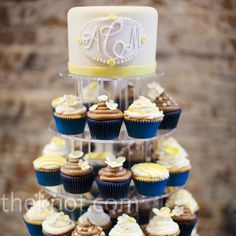 monogrammed cake with cupcakes