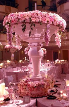 Pretty in Pink Floral Centerpieces | Inspirations from the Preston Bailey Design Team - Hey is that a fountain at the top of this arrangement.  Stunning!!!