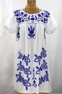 "Vintage inspired Mexican peasant dress dyed, distressed and embroidered by hand. Siren's ""La Azulita"" Hand-Embroidered Vintage-Mexican Style Peasant Dress in white with blue embroidery. Floral Embroidery Patterns, Mexican Embroidery, Cutwork Embroidery, Embroidered Caps, Casual Dresses, Summer Dresses, Mexican Dresses, Muslin Fabric, Mexican Style"