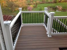 Vinyl Deck with a gate by Wolf Decking.