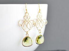 LOVE these little beauties. Royal chandelier with olive green zircon 16k gold earrings.