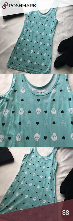Teal Skull Heart Tank Top Super cute aqua blue/teal skull and heart print tank top. Worn a few times. In great condition ! 95% Cotton 5% Spandex. Size Small True to Size . Use the bundle feature to save! thanks for shopping! Tops Tank Tops
