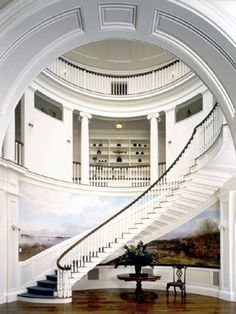 FOYER – great example of an impressive way to welcome guests. Look at the painting on the wall and the large staircase. Houses Architecture, Classical Architecture, Architecture Details, Beautiful Architecture, Foyer Staircase, Staircase Design, Spiral Staircases, Curved Staircase, Interior Exterior