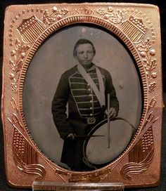 Wonderful plate Ambrotype of Union Drummer Boy. Strapped with his drum, he wears a frock coat with musical front and eagle belt plate. The framed by a patriotic mat featuring Union Shields and Old Glory. Little Boy Poses, Frock Coat, Time Pictures, War Image, Drummer Boy, Civil War Photos, Daguerreotype, Old Glory, Family Crest