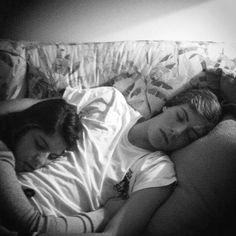 They lay wrapped up, his arm hanging around her, and her arms wrapped tightly around him. As if she's afraid that he might leave her at night. He never would. He loves her too much to just leave. -Gale