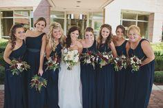 The bridesmaids wore a navy blue Bill Levkoff bridesmaid dresses // Jordanne + Ryan Photography
