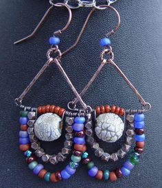 Exotic Swag Earrings with a Mediteranean Flair - Handmade Stoneware Beads, Glass and Hand Forged Copper. $32.50, via Etsy.