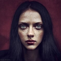 "I haven't been able to confirm, but this looks like an ultraviolet photo to me. The ""freckles"" are characteristic of UV and may not be visible in ordinary light. (Other photos in this series of portraits also have the freckles.)"