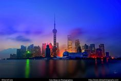 The Shanghai skyline in a unique, colorful illumination. #DarrellLew