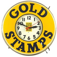 Gold Stamps neon clock, mfgd by Countryman