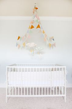 i think i'd leave out the clouds, but i love the bunting draped over the crib.