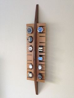 Handmade surf inspired watch display rack in solid walnut and cherry wood on Etsy, £91.55