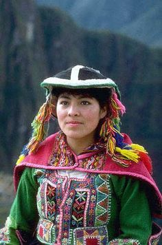 This image of a Quechua woman shows the embellishment details sewn on her jobona. This culture use a variety of embellishments, and the embellishment designs vary depending on the region the Quechua Indian is from.