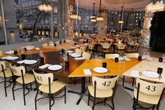 Instead of hosting a show at the Mercedes-Benz Fashion Week tents in 2011, Lacoste hosted a dinner for 40 at its Fifth Avenue store. The Manhattan space was under construction, so the apparel brand dressed it up with a stained and varnished plywood table under the exposed ceilings and wires, and marked chairs simply with numbers instead of place cards.  Photo: Jamie McCarthy/WireImage.com