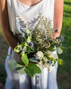 DIY greenery and thistle bridesmaid bouquet Thistle Bouquet, Gypsophila Bouquet, Rustic Bouquet, Diy Wedding Bouquet, Bridesmaid Bouquet, Bride Flowers, Wedding Flowers, Hanging Centerpiece, Dark Blue Flowers