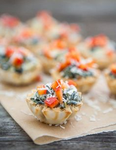 Spinach Artichoke Bites are a gorgeous addition to the appetizer table at your next party with the girls! Your guests will love the crunchy outside shell and the cheesy center.