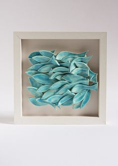 ceramic wall art, fish tile, sculptural pottery wall hanging, modern, nautical home decor in white and blue, handmade by karoArt, Ireland. €82.00, via Etsy.