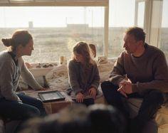 On set photograph of Bonnie Wright talking to David Thewlis and Emily Dunham between takes.