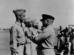 Gen. Benjamin O. Davis pins the Distinguished Flying Cross on his son,  Lt. Col. Benjamin Davis, Jr.