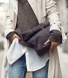 Lisa Olsson with her grey suede clutch bag from Gina Tricot