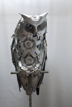 10 Mind-Blowing Sculptures Made From Old Wheel Hubcaps