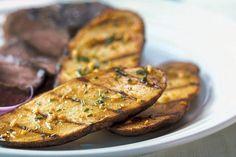 Savory potato slices seasoned just right make a delicious accompaniment to any main dish.