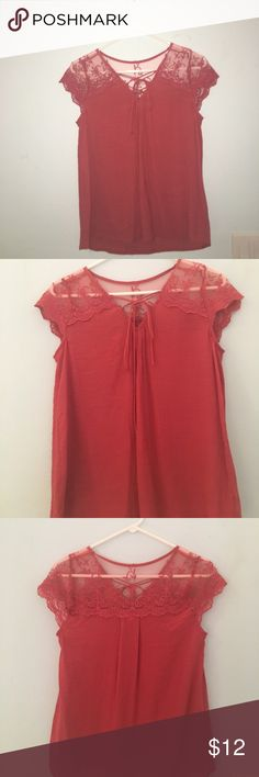 Lace up tshirt Super cute shirt with a lace up in front and lace sleeves and upper back! Only worn once and in perfect condition! Tops