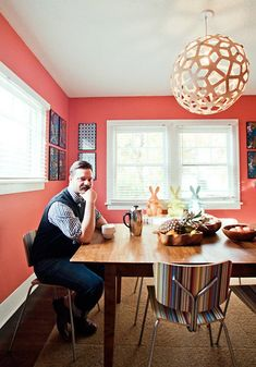 Scott's Cheerful Persimmon Dining Room Roommarks - Paint is Persimmon Red by Martha Stewart. light fixture http://www.davidtrubridge.com/Designs/lighting/kitsets/coral/
