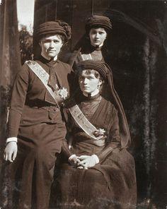 Grand Duchesses Marie, Tatiana and Olga dress for Grand Duke Konstantine Konstantinovich's funeral just prior to the Revolution.