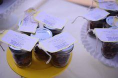 Cupcake in a jar favors served on vintage cake stands