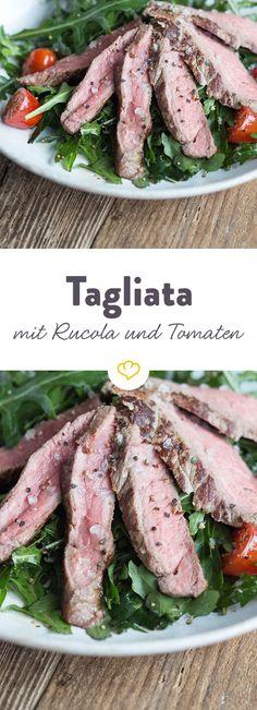 Rosa gebratenes Fleisch auf einem Rucola-Tomaten-Bett.Frisch, leicht und ganz schnell zubereitet. Einfach nur buono!